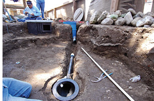 Installation of the drain into the bottom of a pond